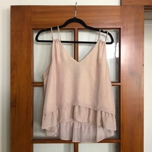 Delicate pink blouse with double straps